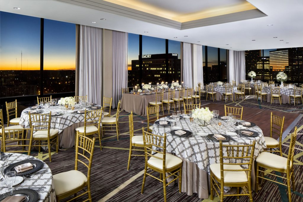 Wedding reception at sunset in the SKY Room East at the Crowne Plaza Atlanta Midtown, overlooking the Atlanta skyline.