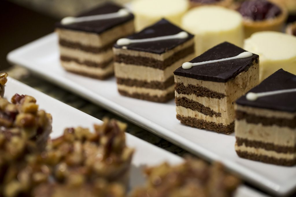 Bite-sized cake desserts on a plate.
