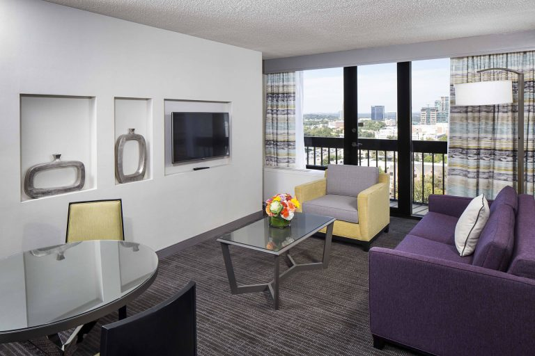 Living room of the king suite, featuring a view of the Atlanta skyline at Crowne Plaza Atlanta Midtown.