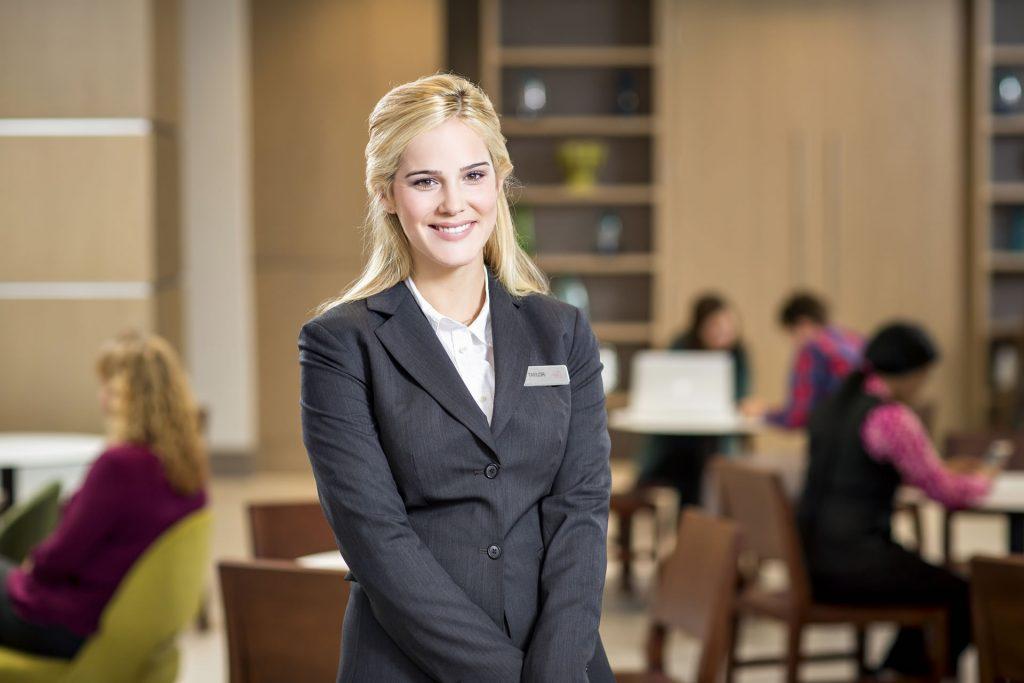 A friendly Crowne Plaza Atlanta Midtown hotel representative smiling for the camera.