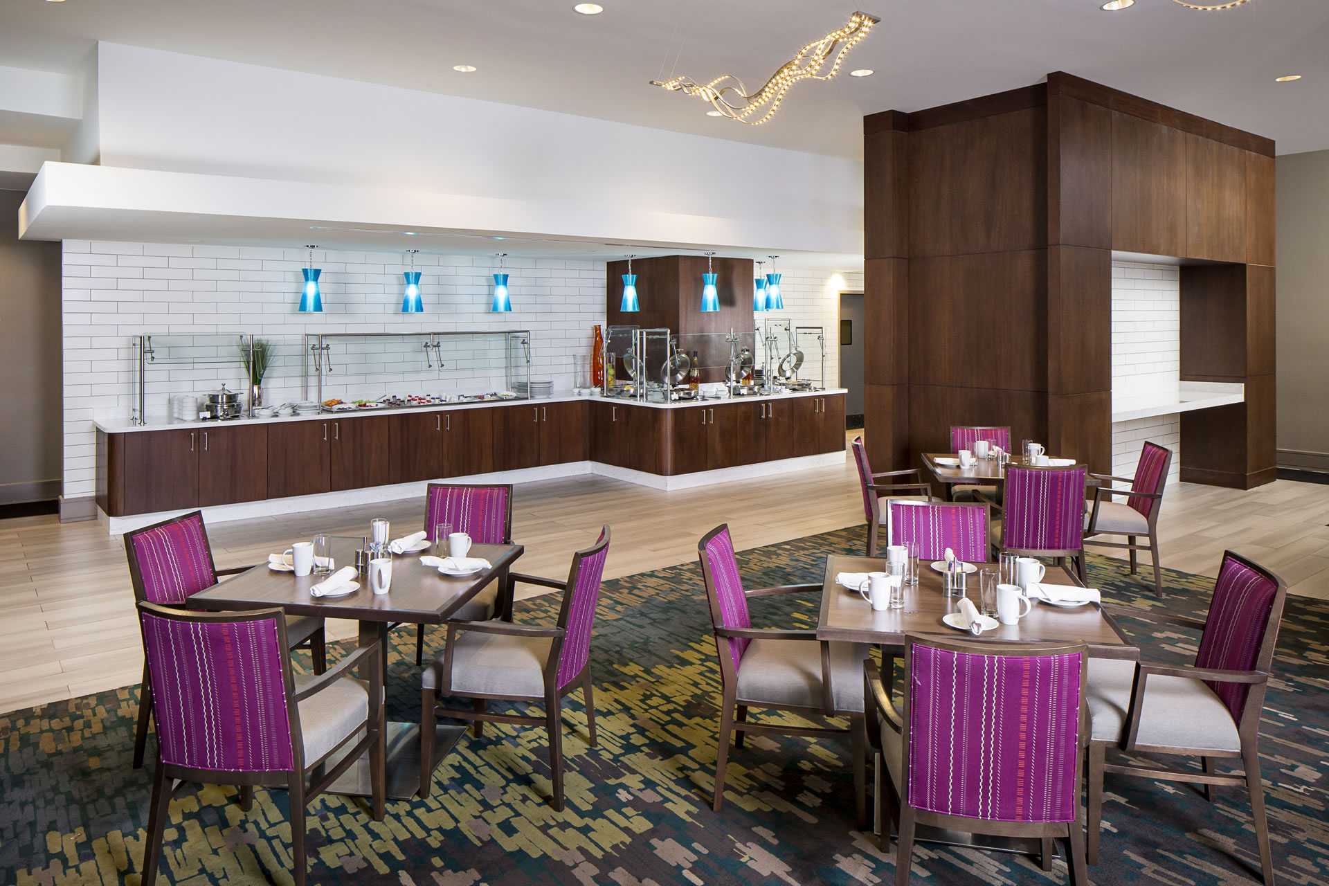 Breakfast buffet and dining tables at First restaurant in Crowne Plaza Atlanta Midtown.
