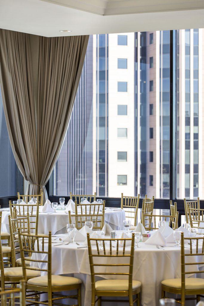 Banquet-style room setup for SKY Room East at Crowne Plaza Atlanta Midtown..