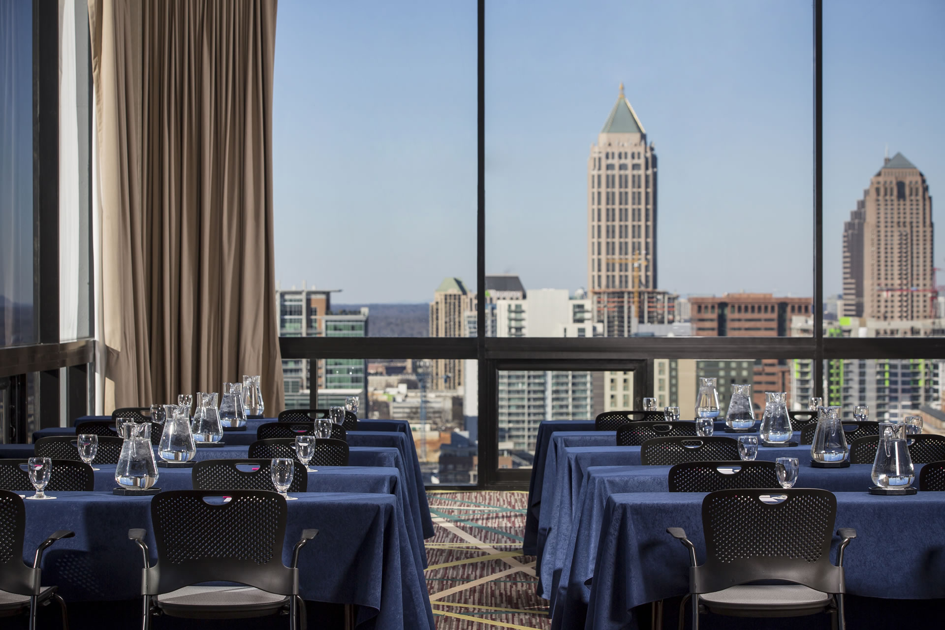 Classroom-style room setup in SKY Room West, overlooking the Atlanta skyline at Crowne Plaza Atlanta Midtown.