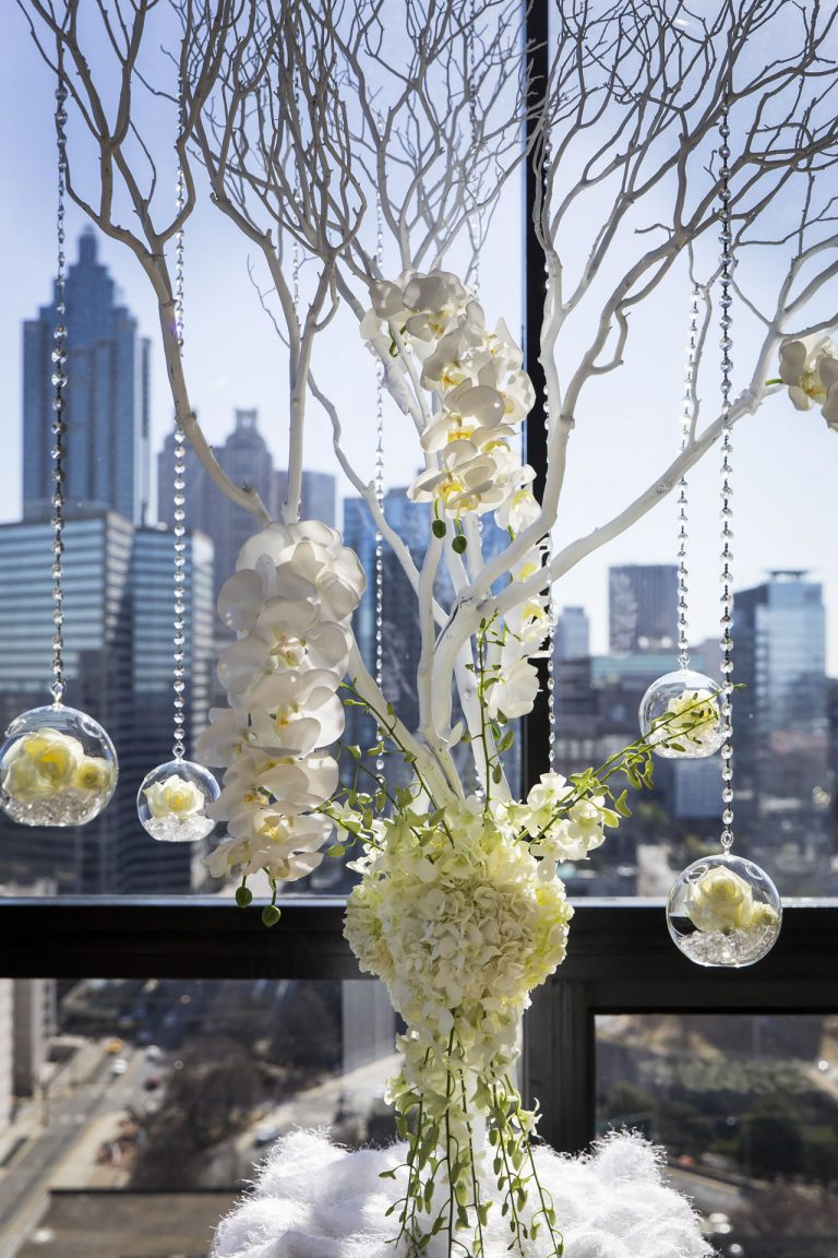 Close up of flowers and glass globe wedding decor in the SKY Room East.