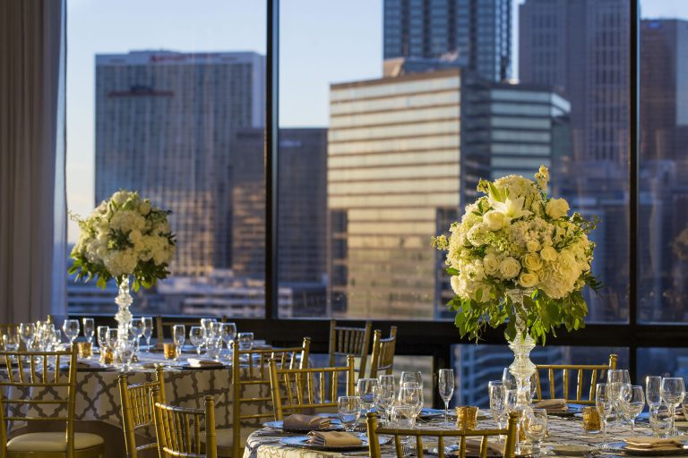 A wedding reception at sundown in the SKY Room East at the Crowne Plaza Atlanta Midtown.