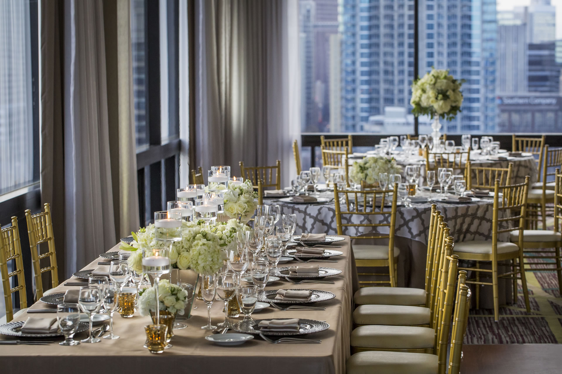 The estate table for a wedding reception at the SKY Room East at the Crowne Plaza Atlanta Midtown.