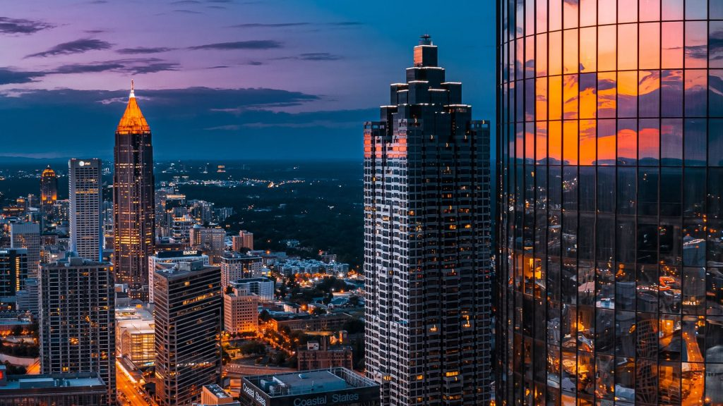 An elevated view of the Atlanta skyline at night.