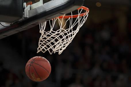 A basketball going through a basketball hoop