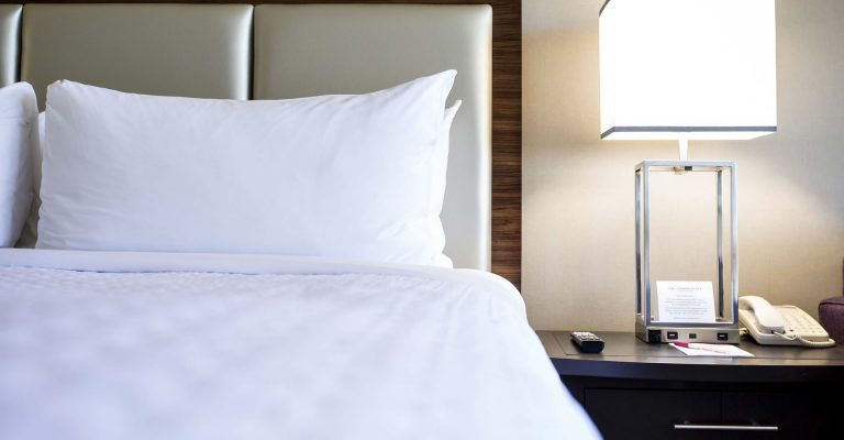 Close up of bed and night stand at Crowne Plaza Atlanta Midtown.