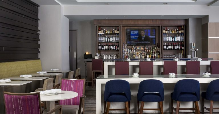 Bar and dining tables at Next restaurant in Crowne Plaza Atlanta Midtown.