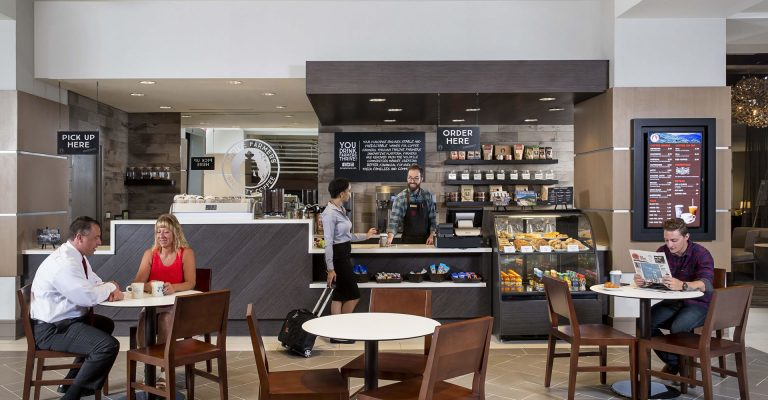 Guests enjoying coffee and snacks at the Java590 cafe in Crowne Plaza Atlanta Midtown.